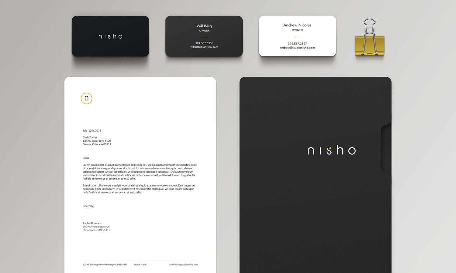 Photo of stationary and business cards designed for new Studio Nisho brand identity.