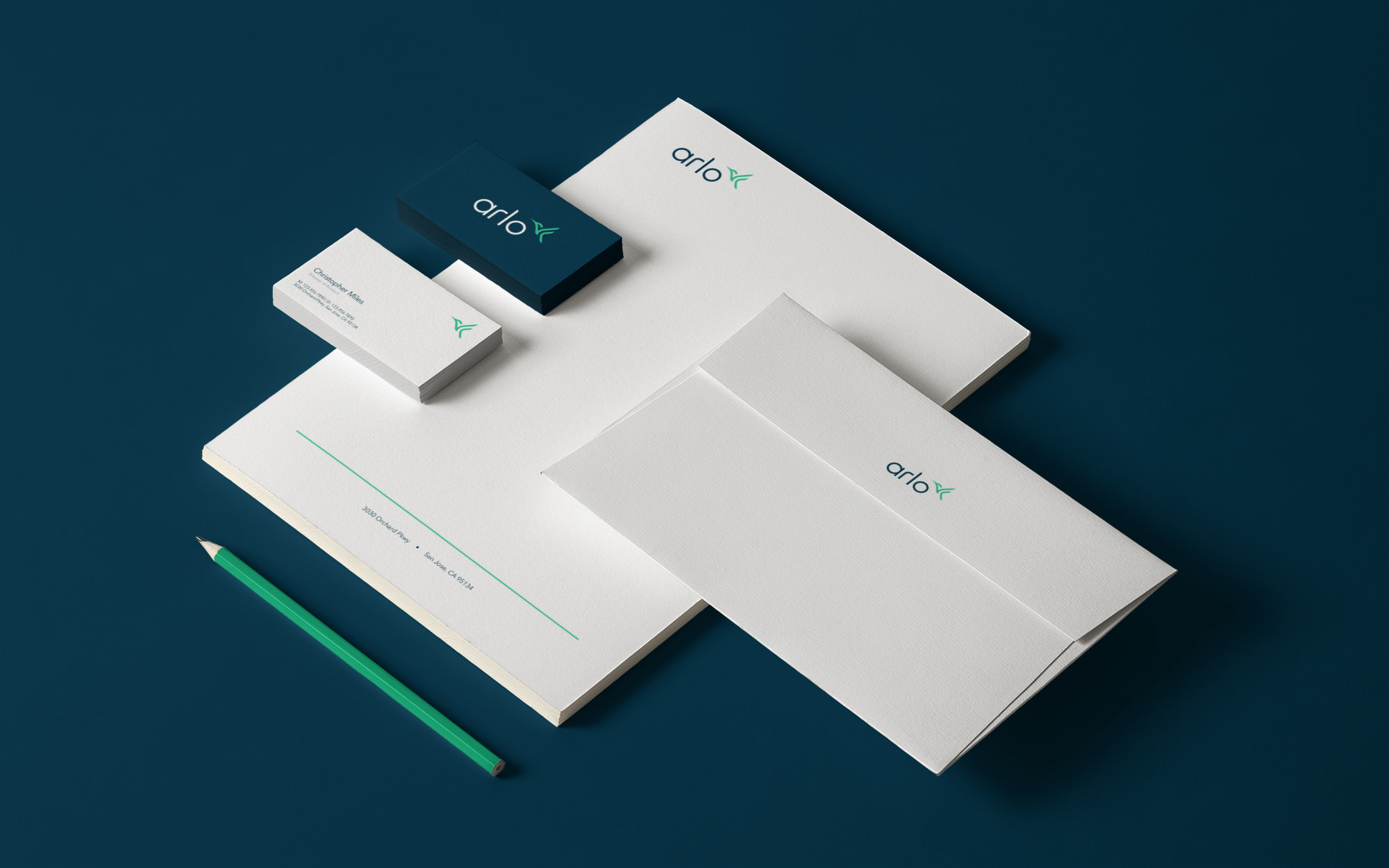 Photo of stationary and business cards designed for new Arlo brand identity.